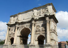 Triumphal arch of Constantine in Rome. Situated between the Colosseum and the Palatine Hill. Summer day with blue sky and some clouds Stock Images