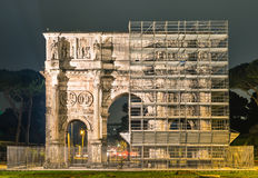 Triumphal arch of Costantine in Rome - Restoration Works. Frontal view of the majestic Triumphal arch of Costantine in Rome - Restoration Works Royalty Free Stock Images