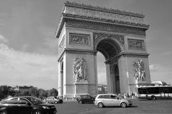 The Triumphal Arch de l Etoile. PARIS, FRANCE OCTOBER 19: The Triumphal Arch de l Etoile ( arc de triomphe) . The monument was designed by Jean Chalgrin in 1806 royalty free stock photography