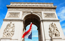 The Triumphal Arch decorated with French flag, Paris, France. The Triumphal Arch decorated with National French flag, Paris, France Stock Photography