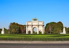 Triumphal Arch at the entrance to Tuileries gardens, Paris. Triumphal Arch Arc de Triomphe du Carrousel at the entrance to Tuileries gardens, Paris, France Royalty Free Stock Photo