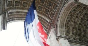 Triumphal Arch and French Flag - Paris, France, Arc de Triomphe Paris, France. Slow motion of French Flag waving at Arc de Triomphe - Triumphal Arch, the symbol stock video
