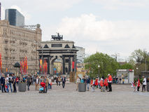Triumphal Arch on Kutuzovsky Prospekt in Moscow. Moscow - May 6, 2016: Arc de Triomphe on Kutuzov Avenue and people walk in Victory Park on Poklonnaya Hill in Stock Images