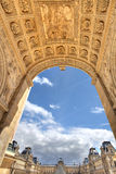 Triumphal Arch and Louvre Royal Palace. Royalty Free Stock Images