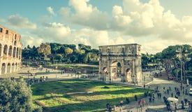 Triumphal arch near Coloseum Stock Images