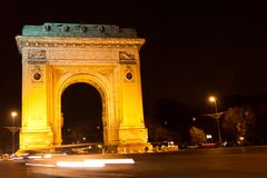 Triumphal arch by night, Bucharest. Arcul de Triumf is a triumphal arch located in the northern part of Bucharest, on the Kiseleff Road. The first, wooden Royalty Free Stock Photography