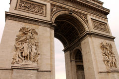 Triumphal Arch in Paris. Front facade of The Triumphal Arch in Paris with heroic bas-reliefs on its surface depicting heroic scenes Stock Images