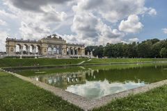 Triumphal arch and pool in the park. The Triumphal arch and pool in the park of Schönbrunn Palace in Austria Stock Image