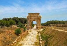 Triumphal Arch of Septimius Severus at ancient Roman ruins of Leptis Magna on the Mediterranean coast of Libya in North Africa stock photos