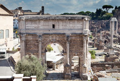 A triumphal arch and Roman Forum, Italy Royalty Free Stock Photos