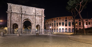 Triumphal arch. Rome. Italy. Night view of The Colosseum and The Arch of Constantine in Rome. Italy Royalty Free Stock Images