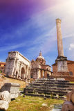 The triumphal Arch of Septimius Severus, Santi Luca e Martina church and the Column of Phocas in the Roman Forum. The triumphal Arch of Septimius Severus, Santi Stock Photos