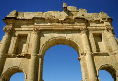 Triumphal arch in Sufetula. Tunisia. Ancient Sufetula (present day Sbeitla). Triumphal arch dedicated to the emperor Antoninus Pious with visible engraved Royalty Free Stock Photography
