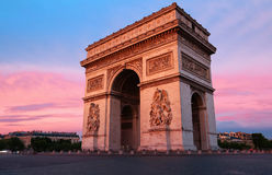 The Triumphal Arch at sunset, Paris, France. The Triumphal Arch is one of the most famous monuments in Paris. It honors those who fought and died for France Stock Image