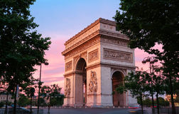 The Triumphal Arch at sunset, Paris, France. The Triumphal Arch is one of the most famous monuments in Paris. It honors those who fought and died for France Royalty Free Stock Images
