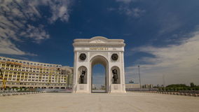 Triumphal arch timelapse hyperlapse and the central part of the city in Astana, Kazakhstan. Triumphal arch timelapse hyperlapse  with national man and woman stock video