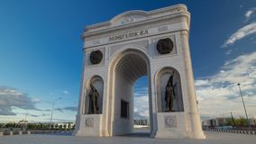 Triumphal arch timelapse hyperlapse and the central part of the city in Astana, Kazakhstan. Triumphal arch timelapse hyperlapse with solders statues and the stock video footage