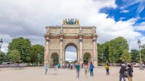 Triumphal Arch timelapse hyperlapse at Tuileries gardens in Paris, France. Triumphal Arch Arc de Triomphe du Carrousel timelapse hyperlapse at Tuileries gardens stock video footage