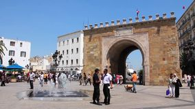 Triumphal arch in Tunis, Tunisia. TUNISIA, TUNIS, JUNE 30, 2010: People near triumphal arch in downtown of Tunis, Tunisia. The triumphal arch at the end of the stock video footage