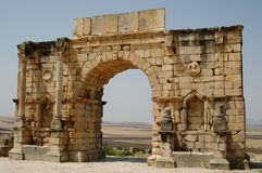 Triumphal Arch - Volubilis Roman City, Morocco. Volubilis Roman city in Morocco situated near Meknes between Fes and Rabat. It developed from the 3rd century BC Royalty Free Stock Photos