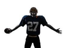 Triumphant american football player man silhouette. One caucasian american football player man triumphant in silhouette studio isolated on white background Stock Photo