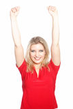 Triumphant woman raising her arms Stock Photo