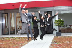 Triumphant business team cheering and celebrating Stock Image