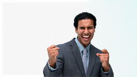 Triumphant businessman in front of the camera. Isolated on a white background stock footage