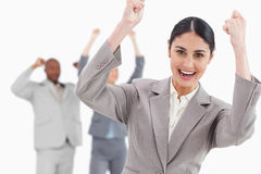 Triumphant businesswoman with cheering associates Stock Photography