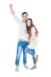 Triumphant couple raising fist Royalty Free Stock Image