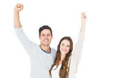 Triumphant couple raising fist Royalty Free Stock Images