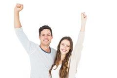 Triumphant couple raising fist Royalty Free Stock Images