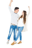 Triumphant couple raising fist Royalty Free Stock Photography