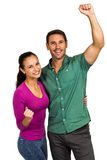 Triumphant couple raising fists Royalty Free Stock Photo