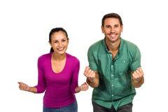 Triumphant couple raising fists Stock Photo