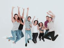 Triumphant group of young people royalty free stock image