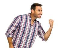Triumphant man raising fist Stock Image
