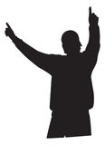 Triumphant Pose. A silhouette of a man with his arms raised, fingers extended in a triumphant gesture. Could also be viewed as a fan in a stadium cheering Stock Image