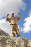 Triumphant Senior MAN!. Triumphant senior man after having climbed to the top of a mountain. To view all four of the images in this series keyword: khaki/man Royalty Free Stock Photography