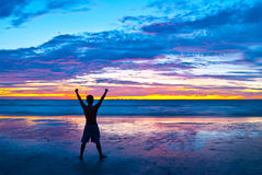 Triumphant youth. In a colorful sunset Stock Photos
