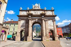 Triumphpforte Gate in Innsbruck. INNSBRUCK, AUSTRIA - MAY 22, 2017: Triumphpforte is one of the most famous sights of Innsbruck Altstadt Old Town. Innsbruck is Stock Photo