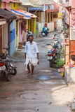 Trivandrum, India - February 17, 2016: happy man in lungi dhotis walks in the street. To the morning prayer in the Indian Temple Sri Padmanabhaswami stock photography