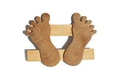 Trivet-feet. Trivet under a cup in the form of human feet Stock Photos