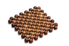 A trivet of juniper beads Royalty Free Stock Photography