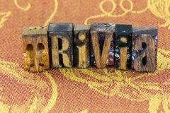 Trivia trivial details letterpress. Wood type block letters sign message cloth background typography stock photography