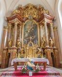 Trnava - altare principale (1755-1757) nella chiesa delle gesuite Fotografia Stock