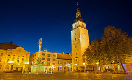 Trnava - The Main square with the bell-tower and the holy Trinity baroque column. Royalty Free Stock Images