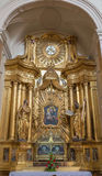 TRNAVA, SLOVACCHIA - 3 MARZO 2014: L'altare barrocco laterale nella chiesa delle gesuite da 18 centesimo Immagine Stock