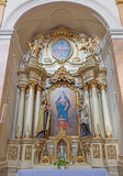 TRNAVA, SLOVAKIA - MARCH 3, 2014: The side baroque altar in Jesuits church from 18. cent.  royalty free stock photo