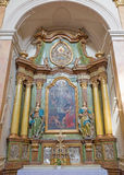 TRNAVA, SLOVAKIA - MARCH 3, 2014: The side baroque altar in Jesuits church from 18. cent.  royalty free stock photography
